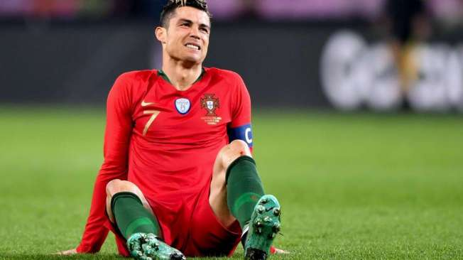 Portugal's forward Cristiano Ronaldo reacts during the international friendly football match between Portugal and Netherlands at Stade de Geneve stadium in Geneva on March 26, 2018. / AFP PHOTO / Fabrice COFFRINI