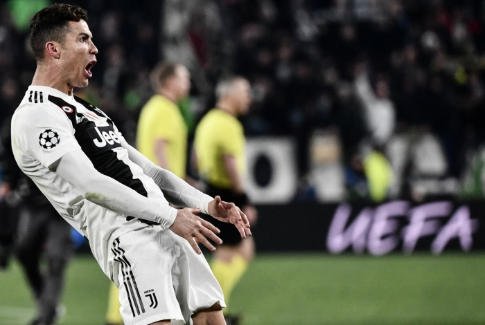 Juventus' Portuguese forward Cristiano Ronaldo celebrates after scoring 3-0 during the UEFA Champions League round of 16 second-leg football match Juventus vs Atletico Madrid on March 12, 2019 at the Juventus stadium in Turin. (Photo by Marco BERTORELLO / AFP)