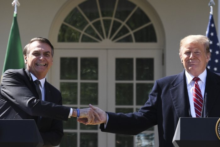 US President Donald Trump shakes hands with Brazil's President Jair Bolsonaro during a joint press conference in the Rose Garden at the White House on March 19, 2019 in Washington, DC. (Photo by Jim WATSON / AFP)