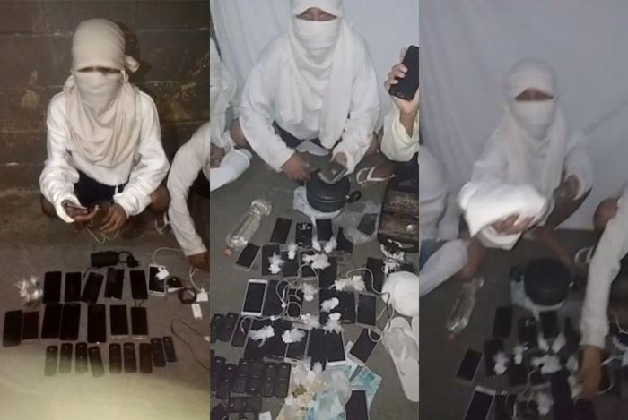 Presos exibem celulares e drogas no Presídio Romeiro Neto, em Magé