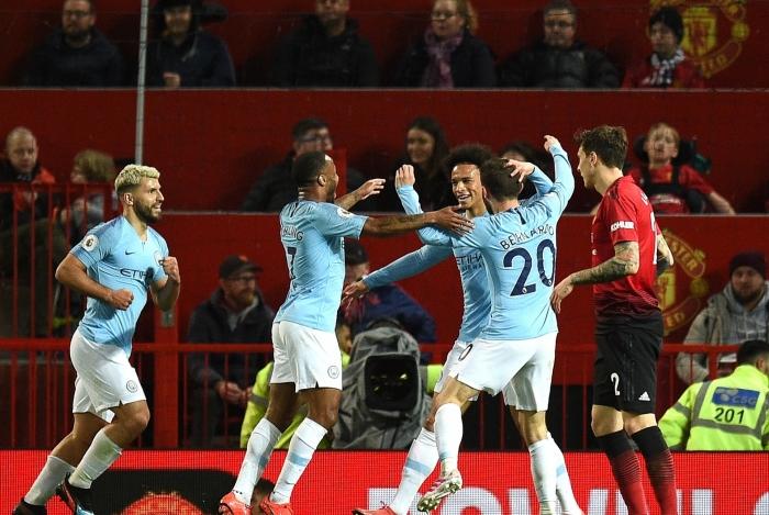 Jogadores do City comemoram a vitória sobre o United, em Old Trafford