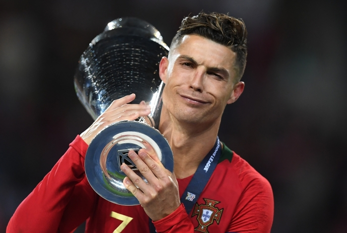 Portugal's forward Cristiano Ronaldo receives the trophy after winning the UEFA Nations League final football match between Portugal and The Netherlands at the Dragao Stadium in Porto on June 9, 2019. (Photo by PATRICIA DE MELO MOREIRA / AFP)