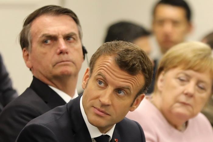 Bolsonaro, Macron e Angela Merkel na cúpula do G20, em junho, em Osaka, no Japão