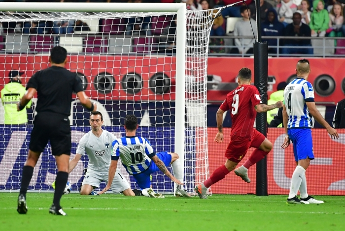 Liverpool's Brazilian midfielder Roberto Firmino (2nd-R) scores during the 2019 FIFA Club World Cup semi-final football match between Mexico's Monterrey and England's Liverpool at the Khalifa International Stadium in the Qatari capital Doha on December 18, 2019. (Photo by Giuseppe CACACE / AFP)