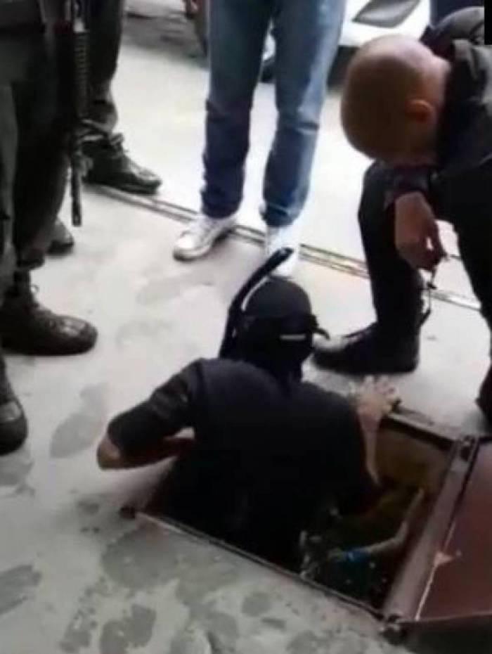 Mergulhador entra em cisterna para procurar arma utilizada no assassinato de Marielle e Anderson