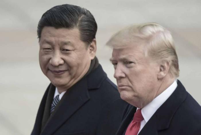 Presidente da China, Xi Jinping, e Donald Trump, em encontro em 2017