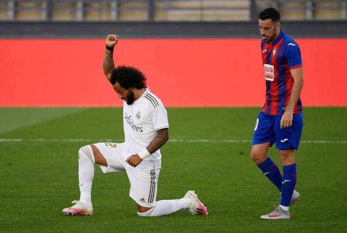 Real Madrid's Brazilian defender Marcelo kneels on the field to celebrate his goal during the Spanish League football match between Real Madrid CF and SD Eibar at the Alfredo di Stefano stadium in Valdebebas, on the outskirts of Madrid, on June 14, 2020. (Photo by PIERRE-PHILIPPE MARCOU / AFP)