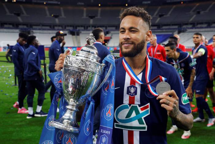 Paris Saint-Germain's Brazilian forward Neymar celebrates with the trophy after winning the French Cup final football match between Paris Saint-Germain (PSG) and Saint-Etienne (ASSE) on July 24, 2020, at the Stade de France in Saint-Denis, outside Paris