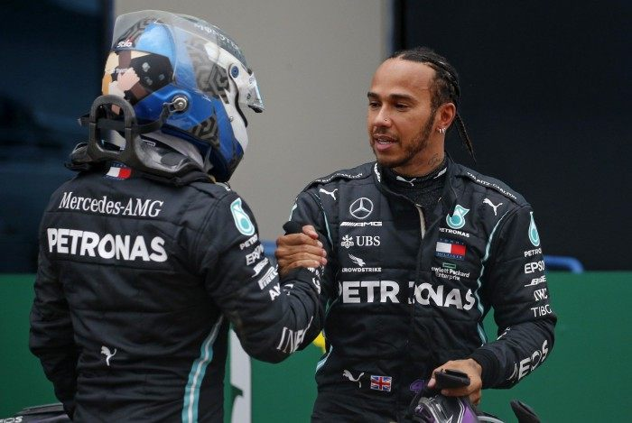 Mercedes' Finnish driver Valtteri Bottas (L) congratulates Mercedes' British driver Lewis Hamilton (R) after winning the Turkish Formula One Grand Prix at the Intercity Istanbul Park circuit in Istanbul on November 15, 2020. (Photo by Kenan Asyali / POOL / AFP)