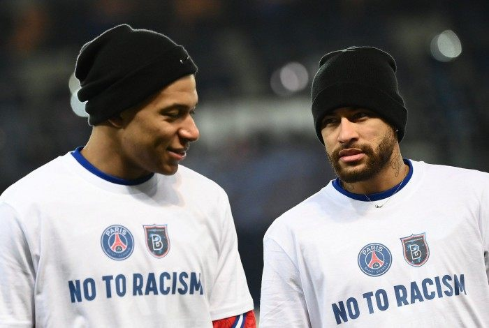 Paris Saint-Germain's French forward Kylian Mbappe (L) and Paris Saint-Germain's Brazilian forward Neymar, wearing tshirt reading