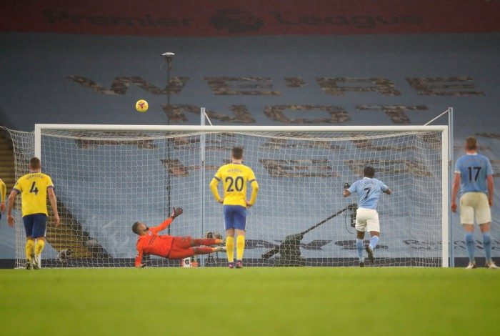 Manchester City's English midfielder Raheem Sterling (2R) shoots from the penalty spot but fails to score during the English Premier League football match between Manchester City and Brighton and Hove Albion at the Etihad Stadium in Manchester, north west England, on January 13, 2021. Clive Brunskill / POOL / AFP
