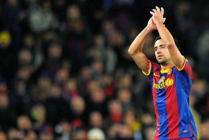Xavi em seus tempos de Barcelona