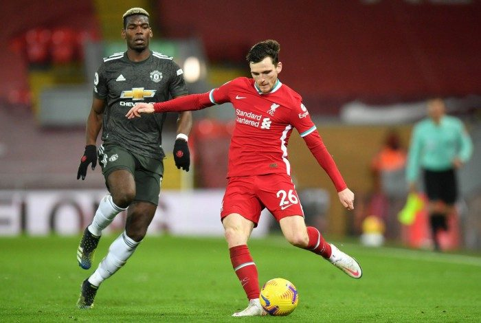 Manchester United's French midfielder Paul Pogba (L) vies with Liverpool's Scottish defender Andrew Robertson (R) during the English Premier League football match between Liverpool and Manchester United at Anfield in Liverpool, north west England on January 17, 2021.