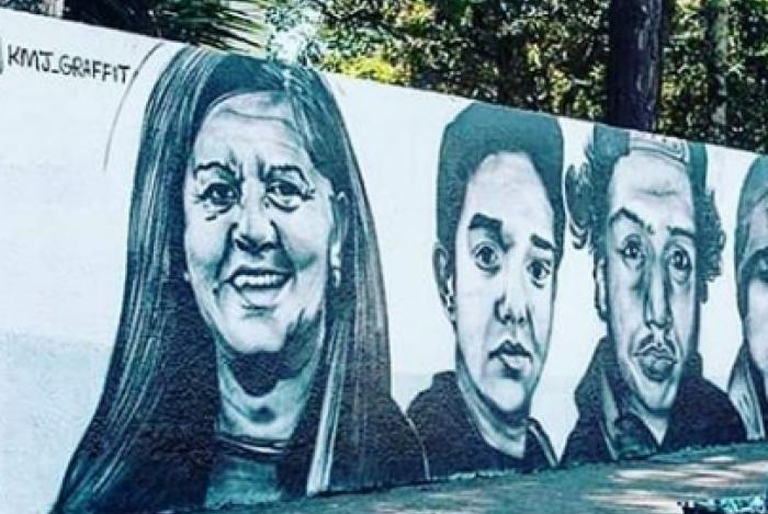 Grafiteiro homenageia vítimas em muro da escola Raul Brasil, em Suzano